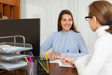 Woman answer questions of employee