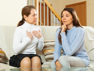 mother with  teen daughter having  conversation