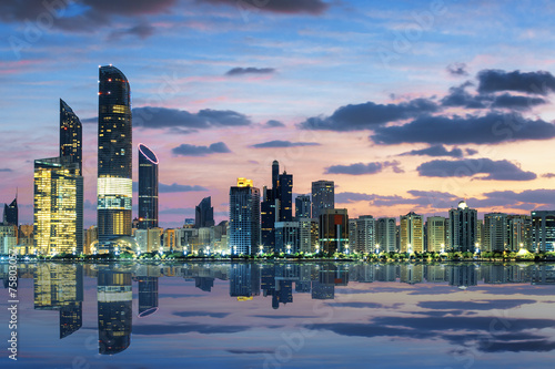 Staande foto Midden Oosten View of Abu Dhabi Skyline at sunset