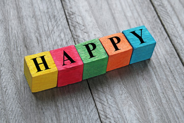 word happy on colorful wooden cubes