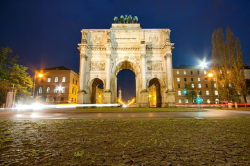 The Siegestor (Victory Gate) at night in Munich, Germany, Europe