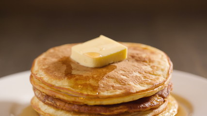 classic pancakes with butter and maple syrup, hd footage