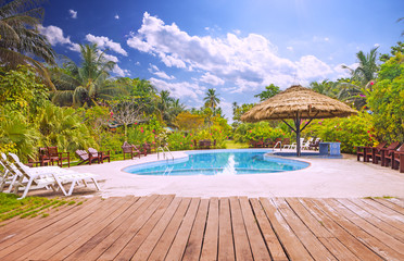 Resort swimming pool with empty plank board