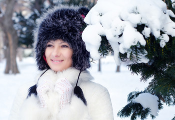 Beautiful elegant lady in winter forest