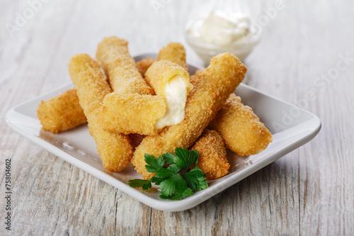 fried mozzarella cheese sticks breaded - 75804602