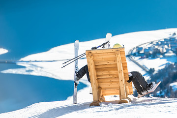 Skier and snowboarder at rest.