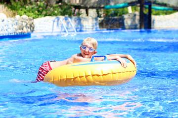 Happy boy having fun in water park