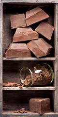 Dark chocolate in vintage box. Food background