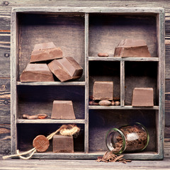 Dark chocolate in vintage box. chocolate food background