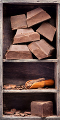 Dark chocolate and cocoa beans in a vintage box. Food background