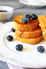 French toast with blueberries on a white plate