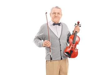 Mature violinist posing with his violin