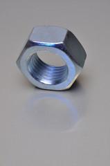 Single nut with blue light reflection