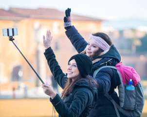 PISA, ITALY - JANUARY 6, 2015: Two happy famale young tourists p