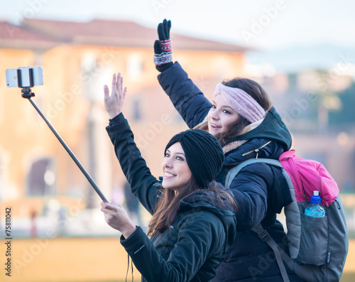 canvas print picture PISA, ITALY - JANUARY 6, 2015: Two happy famale young tourists p