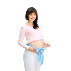 Happy smiling pregnant woman on a white background