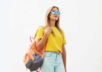 Street fashion concept - stylish hipster girl in sunglasses outd