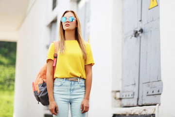 Street fashion concept - bright hipster girl in sunglasses outdo