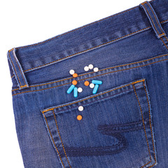Pills in the pocket of jeans.