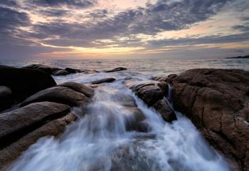 wave reaching the stone beach, Thailand