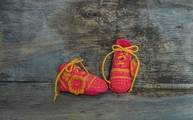 felted pink baby shoes