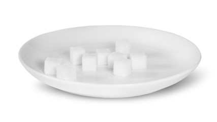 Sugar Cubes On A White Plate