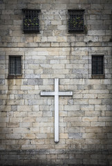 cross on a wall with windows