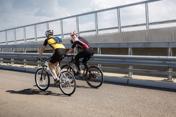 Two professional cyclists taking a training ride
