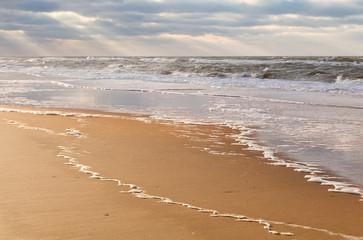 sunbeams over North sea beach