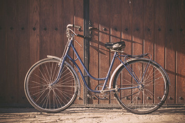 Old or classic bicycle on a wooden door