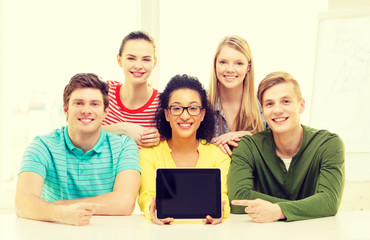 smiling students showing tablet pc blank screen