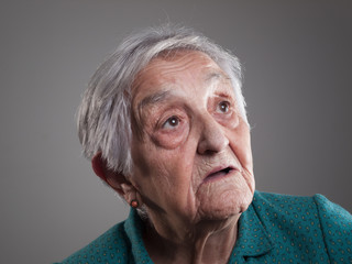 Elderly woman portrait in a studio shot.