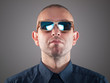 Man with sunglasses in a studio shot
