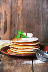 Stack of pancakes with mint and butter
