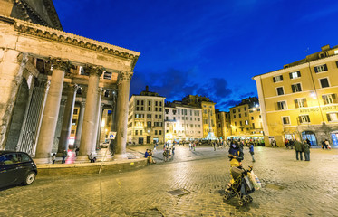 ROME - MAY 18, 2014: Tourists walk in Pantheon Square at night.