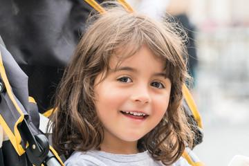 Smiling baby girl on the stroller