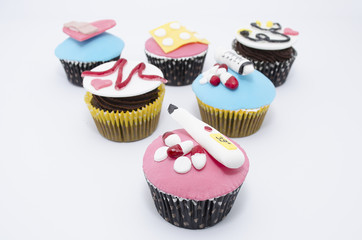 Cupcakes with medical equipment made of fondant