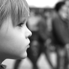 Closeup profile of a thoughtful child, monochrome