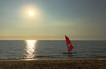 man played windsurf at Pattaya beach, Thailand.