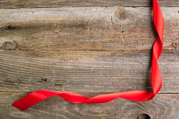 Red satin ribbon on reclaimed wood, valentines day background