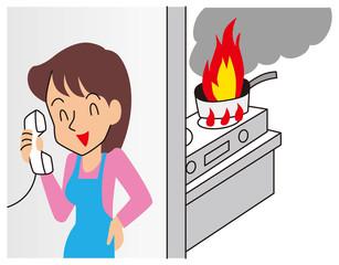電話に夢中で小火を出す女性