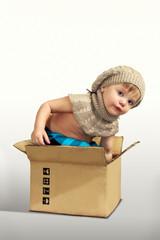 Boy posing in box