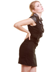Backache. Young woman suffering from back pain isolated