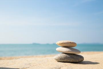 Stones balance, pebbles stack on sea sand beach