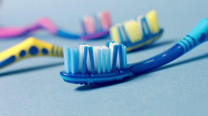 Сolored toothbrushes and toothpaste