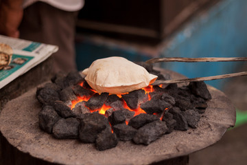 Cooking bread on coals