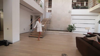 Beautiful woman quickly goes down the stairs at home3