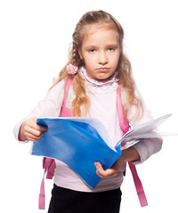 Sad child with schoolbag