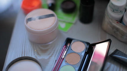A closeup, makeup  table with makeup equipment