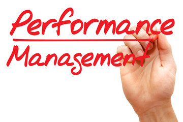 Hand writing Performance Management with red marker
